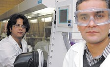 Sumit Chaudhary, right, and graduate assistant Rakesh Mahadevapuram, in the organic electronics laboratory at Iowa State University's Applied Sciences Complex.
