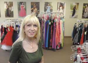 Owner Cheryl Angier wants women to stop by and rent dresses for special occasions as well as holiday parties and special dates. Photo by Duane Tinkey