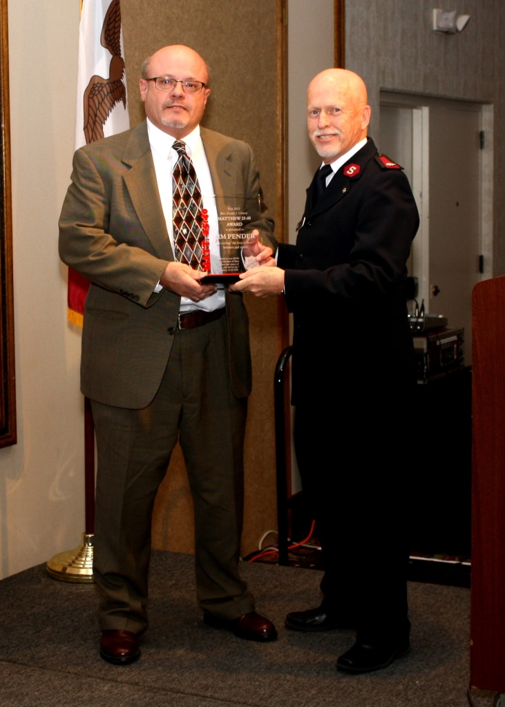 Jim Pender (left) received the Rev. Duane Gibson Matthew 25:40 Award at Thursday's Salvation Army annual dinner meeting. The award was presented by Major David Corliss.